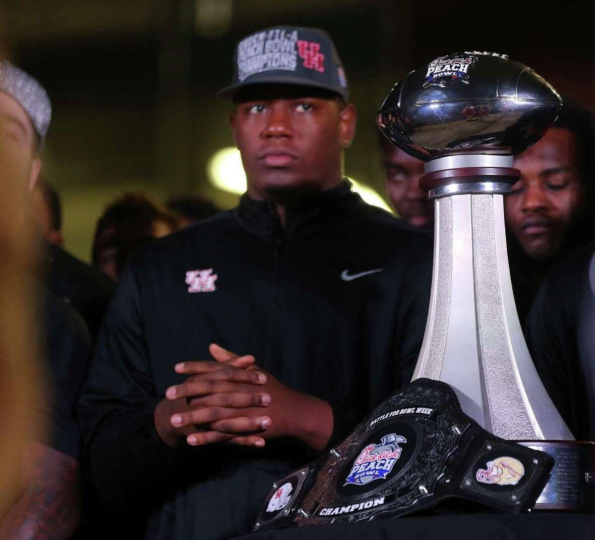 The Peach Bowl trophy is on display during a rally for the UH football team's Peach Bowl win outside TDECU Stadium on Monday, Feb. 1, 2016.