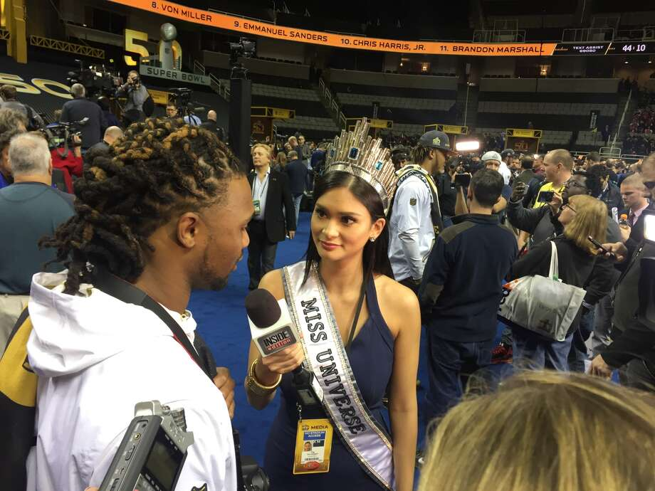 Miss Universe 2015 Pia Alonzo Wurtzbach interviews players on the floor of Super Bowl Opening Night. Photo: Mariecar Mendoza, The Chronicle