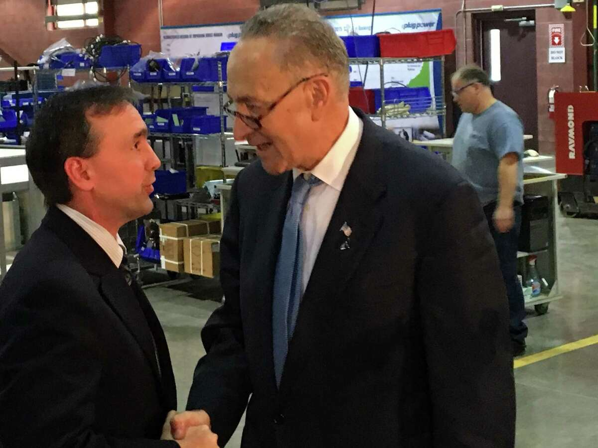 U.S. Sen. Charles Schumer meets with Dr. Marcus Martinez of Hoosick Falls, left, on Monday after a press conference Schumer held at the headquarters of Plug Power in Latham. Schumer called on Saint-Gobain to expediate the flow of information in the Hoosick Falls water crisis investigation.