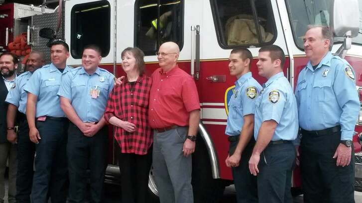 Cindy Musemeche and her husband, Chris, on Monday visited the Houston firefighters from Station 21 who helped save her after she went into cardiac arrest last July.