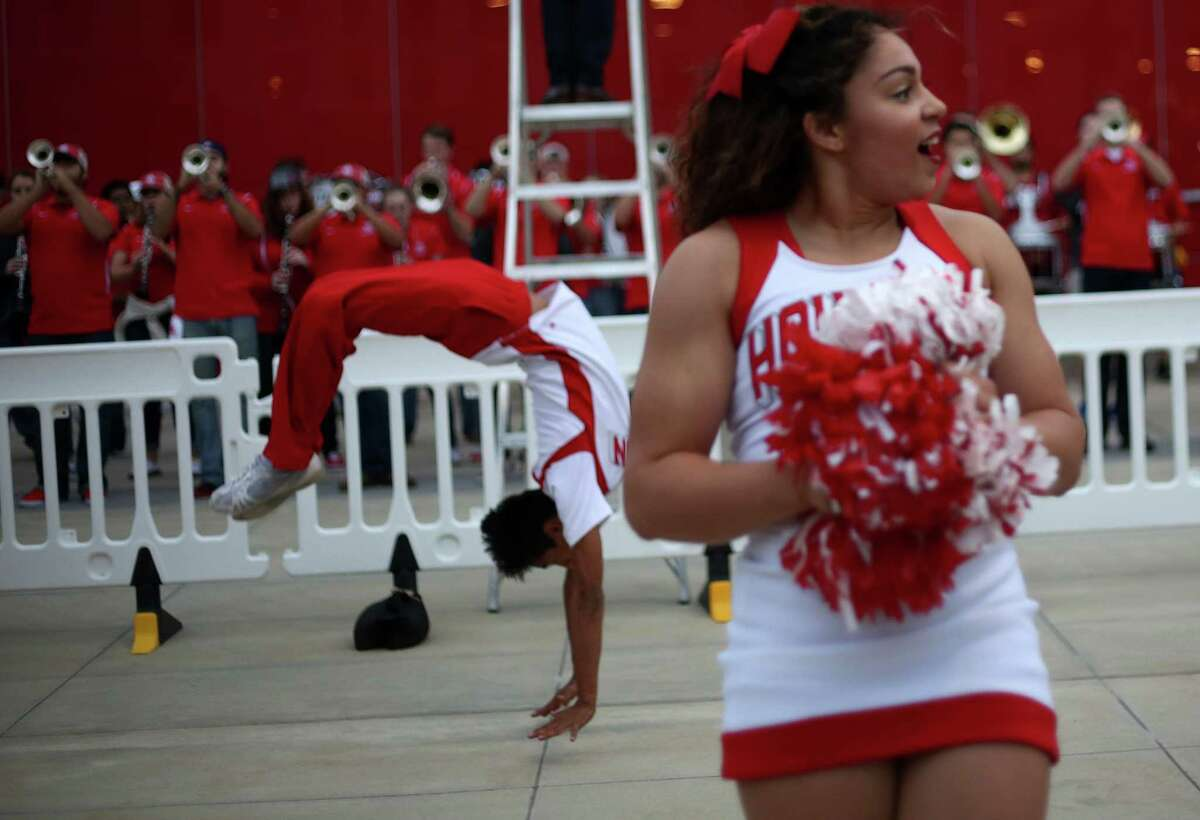 Cheerleaders liven up the crowd before a rally for the UH football team's Peach Bowl win outside TDECU Stadium on Monday, Feb. 1, 2016.