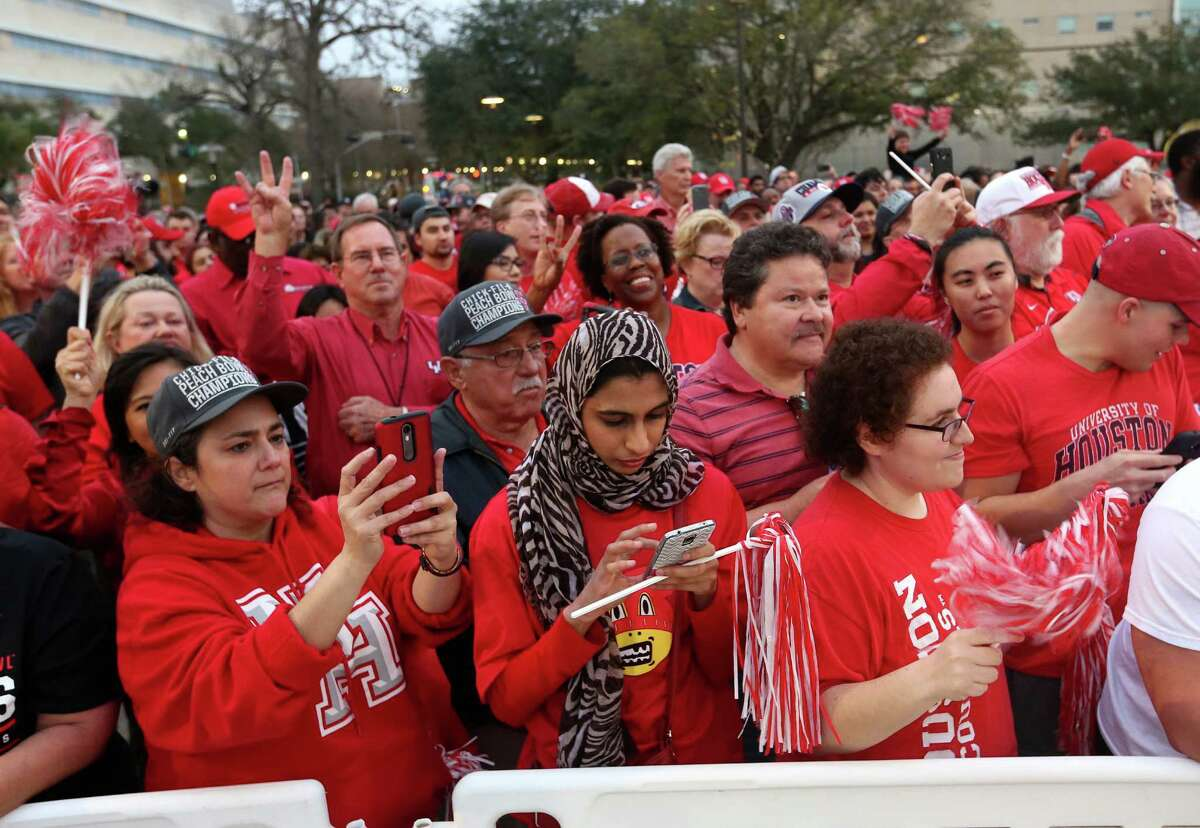 Fans fill up the sidewalk for a rally for the UH football team's Peach Bowl win outside TDECU Stadium on Monday, Feb. 1, 2016.