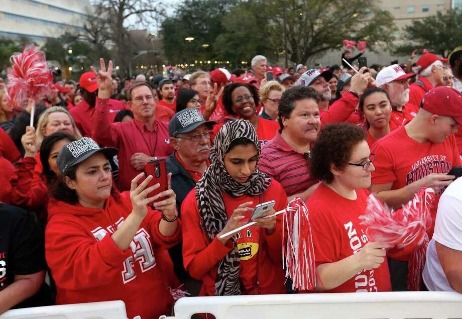 Fans fill up the sidewalk for a rally for the UH football team's Peach Bowl win outside TDECU Stadium on Monday, Feb. 1, 2016. Photo: Elizabeth Conley, Houston Chronicle / © 2016 Houston Chronicle