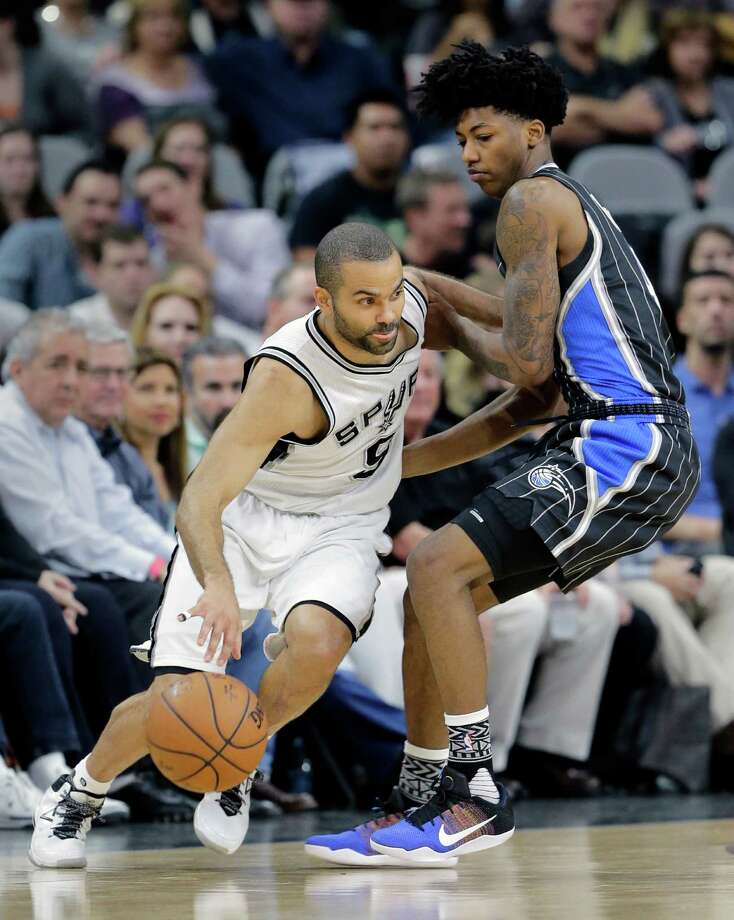 San Antonio Spurs guard Tony Parker (9) drives around Orlando Magic guard Elfrid Payton (4) during the first half of an NBA basketball game, Monday, Feb. 1, 2016, in San Antonio. (AP Photo/Eric Gay) Photo: Eric Gay, Associated Press / AP