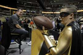 Pick Boy with the Nickelodeon Channel tries to get Broncos head coach Gary Kubiak to ask his football a question at the Super Bowl 50 Opening Night at SAP Center in San Jose, Calif., on Monday, February 1, 2016.