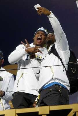 Carolina Panthers' Cam Newton and Jonathan Stewart take a selfie during Super Bowl 50 Opening Night at SAP Center in San Jose, Calif., on Monday, February 1, 2016.