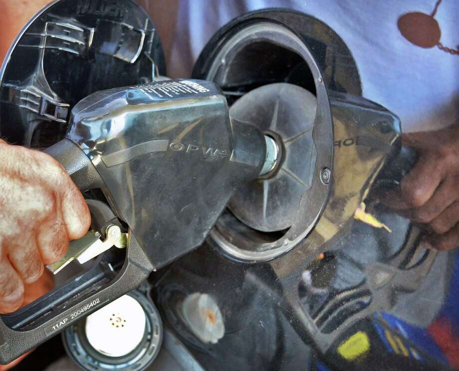 Lester Perkins of Albany pumps gas at the Broadway Sunoco station Tuesday Sept. 15, 2015, in Albany, NY. (John Carl D'Annibale / Times Union archive) Photo: John Carl D'Annibale / 00033371A
