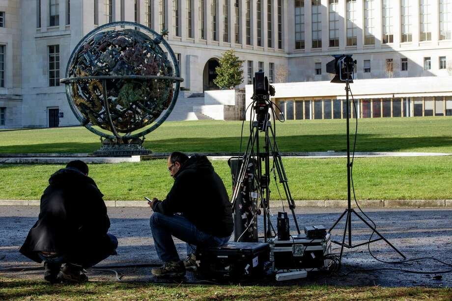 Reporters wait in front the UN building after Syria talks were rescheduled at the European headquarters of the United Nations in Geneva, Switzerland, Monday, Feb. 1, 2016. A spokeswoman for U.N. envoy Staffan de Mistura says indirect talks between the Syrian government and the opposition are likely to be delayed. (Salvatore Di Nolfi/Keystone via AP) ORG XMIT: SDN303 Photo: Salvatore Di Nolfi / KEYSTONE
