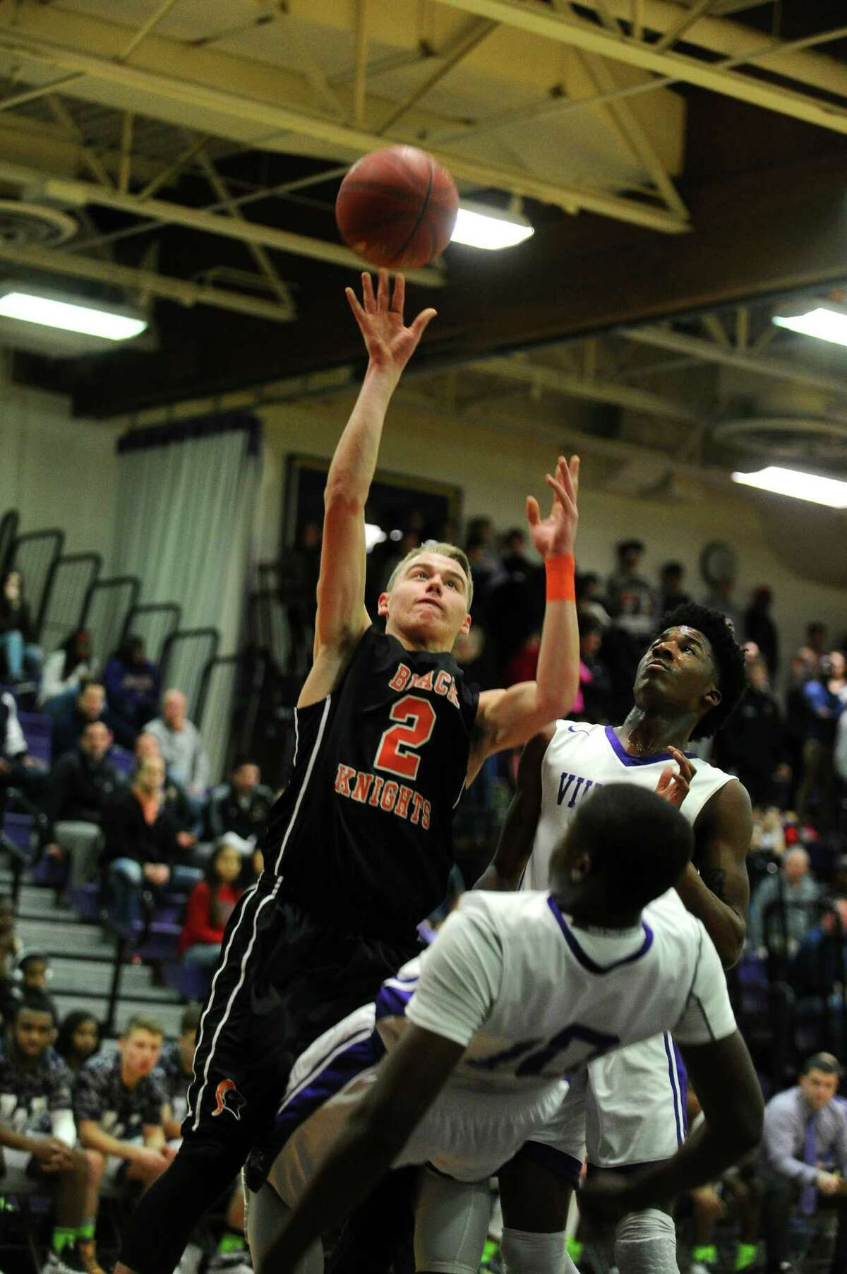 Stamford High senior Jay DeVito lofts a ball over Westhill's Tyrell Alexander during the second quarter of the game at Westhill High School on Monday, Feb. 1, 2016. DeVito was called for a charge.