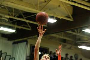 Stamford boys basketball takes city championship with win over Westhill - Photo