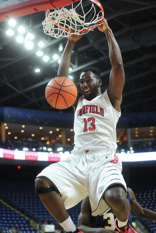 Fairfield University's Jonathan Kasibabu goes in for a slam dunk during the first half of the Stags' MAAC basketball game with Quinnipiac at the Webster Bank Arena in Bridgeport, Conn. on Monday, February 1, 2016. Photo: Brian A. Pounds / Hearst Connecticut Media / Connecticut Post