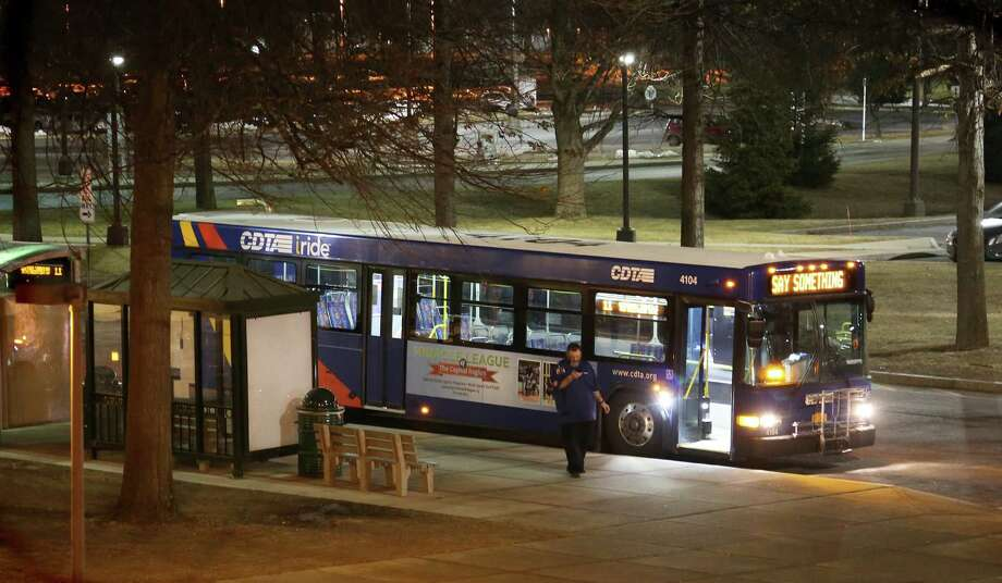 This #11 CDTA bus is parked outside of the Social Sciences building on the UAlbany campus on Feb. 1, 2016. Albany police and the UAlbany Police Department are investigating an incident that occurred along the Western Aveune route that connects the Uptown campus with the Downtown campus. The alleged assault against three students took place early on Jan. 30. (Thomas Palmer/Times Union) Photo: Thomas Palmer