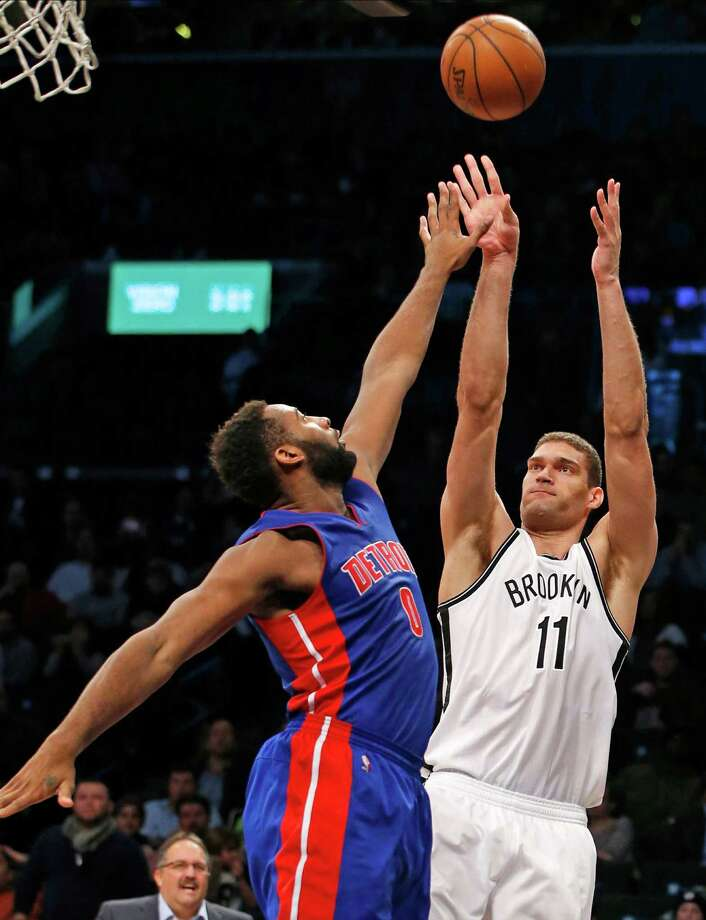 Brooklyn Nets center Brook Lopez (11) Detroit Pistons center Andre Drummond (0)  shoots over in the second half of an NBA basketball game, Monday, Feb. 1, 2016, in New York. The Pistons defeated the Nets 105-100. Although the Nets lost, Lopez tallies 27 points in the game. (AP Photo/Kathy Willens) ORG XMIT: NYKW118 Photo: Kathy Willens / AP