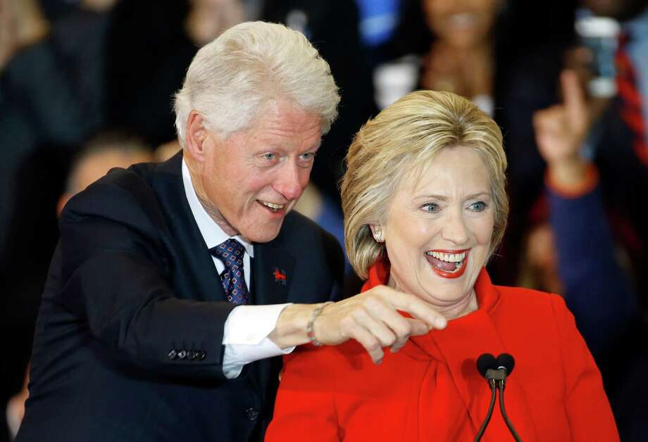 Former President Bill Clinton, left, and Democratic presidential candidate Hillary Clinton acknowledge supporters during a caucus night rally at Drake University in Des Moines, Iowa, Monday, Feb. 1, 2016. Photo: Patrick Semansky, AP / AP