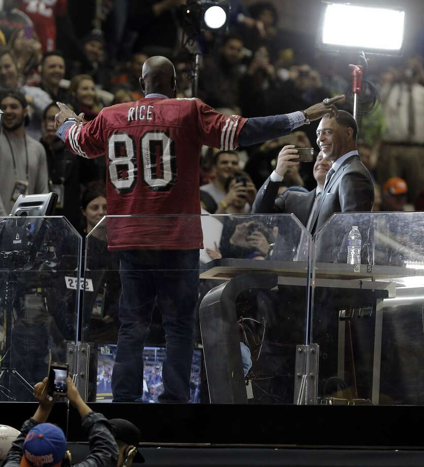 Jerry Rice struts around on stage with a 49ers Rice jersey on as Chris Carter watches at the Super Bowl 50 Opening Night at SAP Center in San Jose, Calif., on Monday, February 1, 2016. Photo: Carlos Avila Gonzalez, The Chronicle