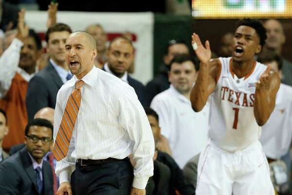 Texas head coach Shaka Smart and Isaiah Taylor (1) celebrate a basket against Baylor late in the second half of an NCAA college basketball game, Monday, Feb. 1, 2016, in Waco, Texas. Texas won 67-59. (AP Photo/Tony Gutierrez)