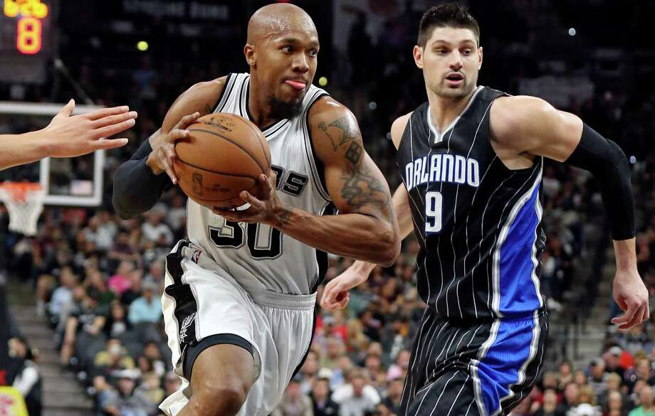 Spurs' David West drives around Orlando Magic's Nikola Vucevic during second half actionon Feb. 1, 2016 at the AT&T Center. Photo: Edward A. Ornelas /San Antonio Express-News / © 2016 San Antonio Express-News
