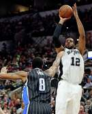 The Spurs' LaMarcus Aldridge shotos over the Magic's Channing Frye during the second half. Aldridge finished with a game-high 28 points and tied his season high with five blocks.