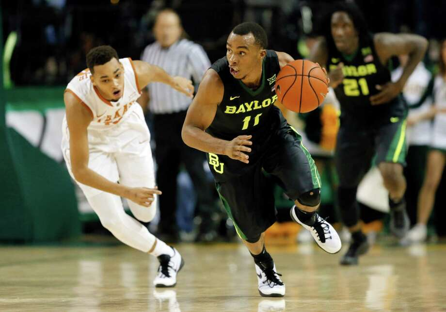 Baylor's Lester Medford (11) comes away with a steal against Texas's Eric Davis Jr., rear, in the second half of an NCAA college basketball game, Monday, Feb. 1, 2016, in Waco, Texas. Texas won 67-59. (AP Photo/Tony Gutierrez) Photo: Tony Gutierrez, STF / Associated Press / AP