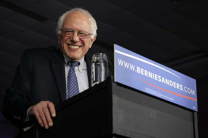 Democratic presidential candidate Sen. Bernie Sanders (I-VT) smiles as he speaks to supporters during a caucus night party February 1, 2016 in Des Moines, Iowa. Sanders finished just behind former Secretary of State Hillary Clinton in the Iowa caucuses.  (Photo by Alex Wong/Getty Images)