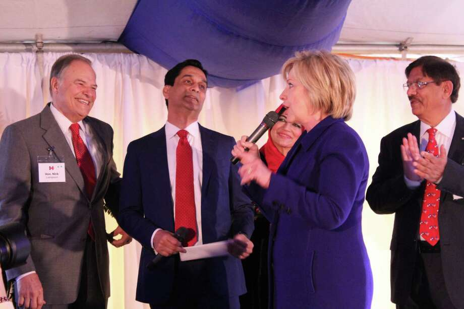 Hillary Clinton, frontrunner for the Democratic presidential nomination, speaks at a private fundraiser held Wednesday in Beaumont. Former Congressman Nick Lampson and Clinton's hosts, Tahir and Rubina Javed, look on.Click through the slides to see how much Clinton, Cruz and other presidential candidates have spent so far. Photo: Courtesy