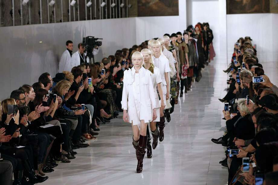 John Galliano's creations for Maison Margiela's 2016 spring/summer haute couture collection included an off-white trench coat and baggy black riding boots. Photo: FRANCOIS GUILLOT, Staff / AFP