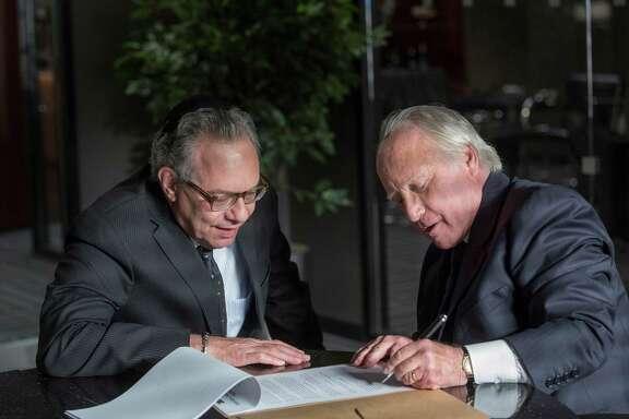 "Lewis Black, left, plays duped investor Ezra Merkin and Richard Dreyfuss stars as the titular con man Bernard Madoff in the miniseries ""Madoff."""