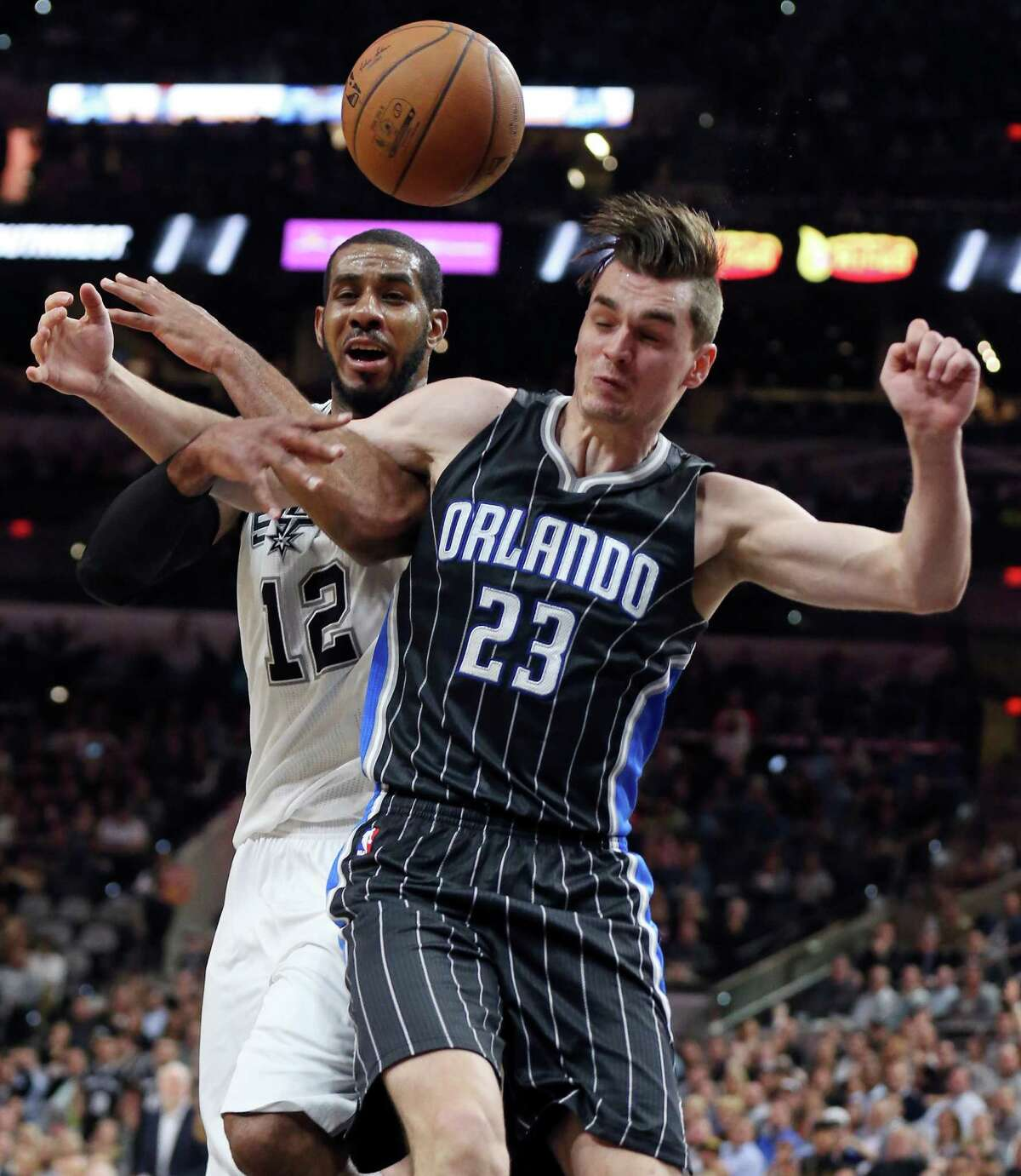 San Antonio Spurs' LaMarcus Aldridge is fouled by Orlando Magic's Mario Hezonja during second half action Monday Feb. 1, 2016 at the AT&T Center. The Spurs won 107-92.