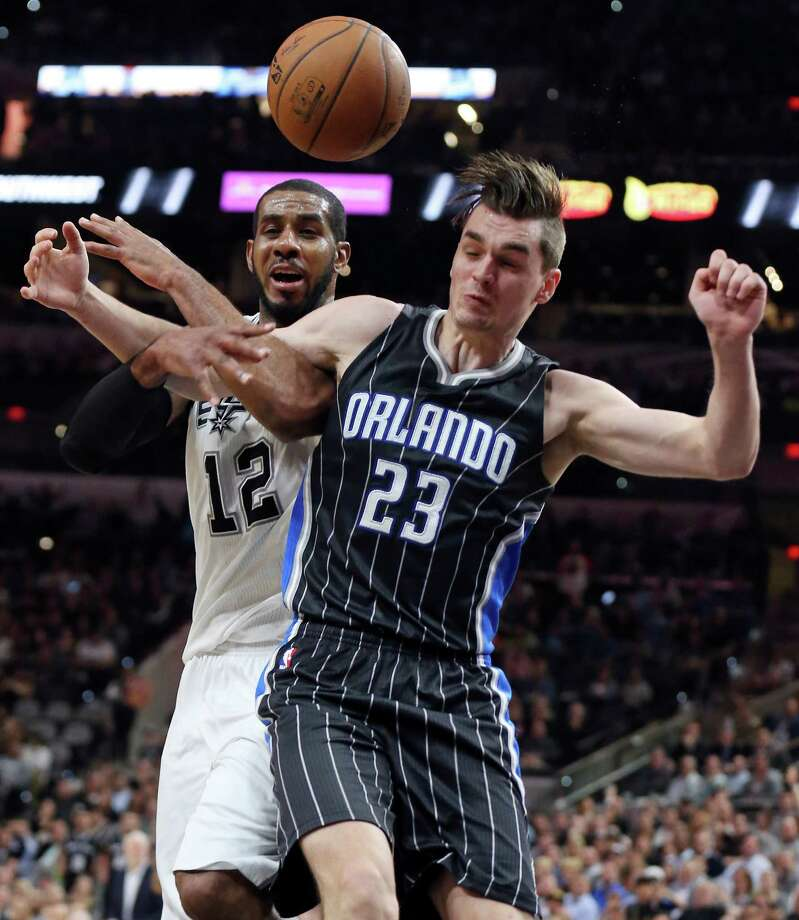 San Antonio Spurs' LaMarcus Aldridge is fouled by Orlando Magic's Mario Hezonja during second half action Monday Feb. 1, 2016 at the AT&T Center. The Spurs won 107-92. Photo: Edward A. Ornelas, Staff / San Antonio Express-News / © 2016 San Antonio Express-News