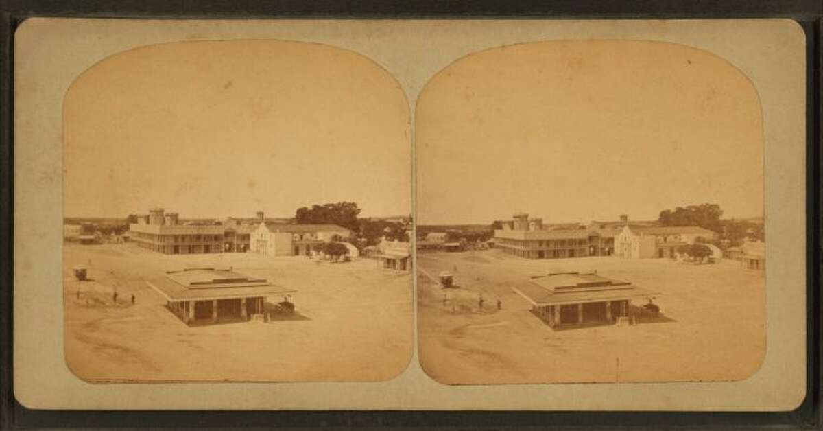 In this view of the Alamo Plaza, the Alamo can be seen in the far right. Stereoscopic view, 1876-1879