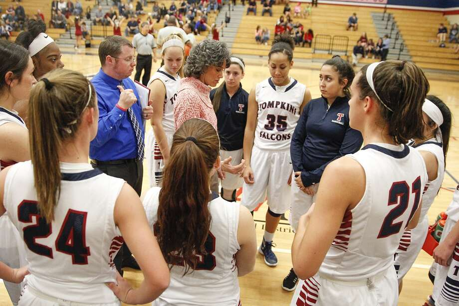 Tompkins girls basketball coach Tamantha Ray gives the Lady Falcons instructions during a time out as they took on Mayde Creek in district play at Tompkins High School on January 29, 2015. Photo: Diana L. Porter, Freelance / © Diana L. Porter