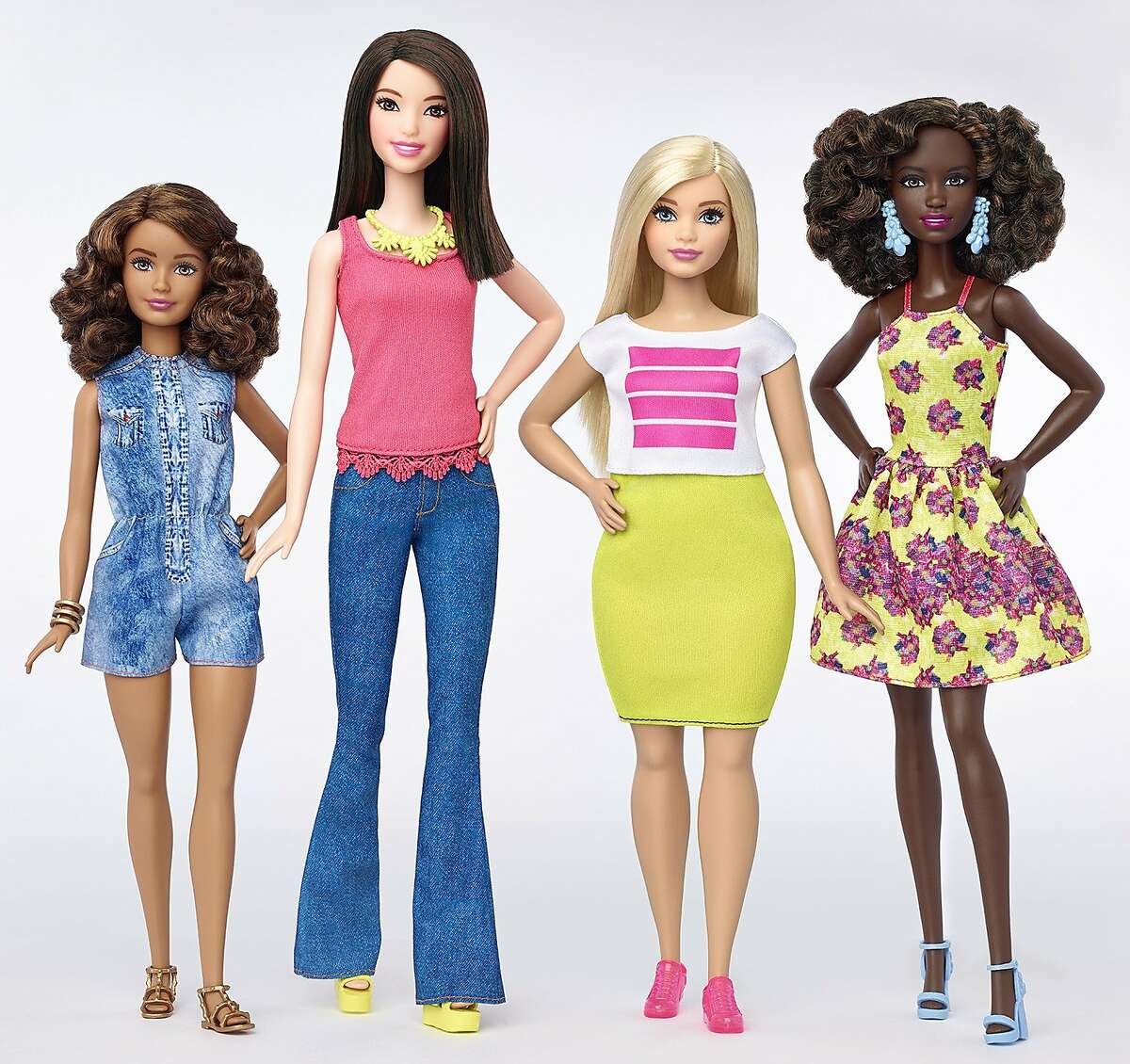FILE - This file photo provided by Mattel shows a group of new Barbie dolls introduced in January 2016. Mattel reports financial results Monday, Feb. 1, 2016. (Mattel via AP, File)