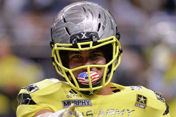 West defensive back Byron Murphy gestures to an acquaintance on the sideline during the second half of the Army All American Bowl high school football game against the East, Saturday, Jan. 9, 2016, in San Antonio. West won 37-9. (AP Photo/Darren Abate)