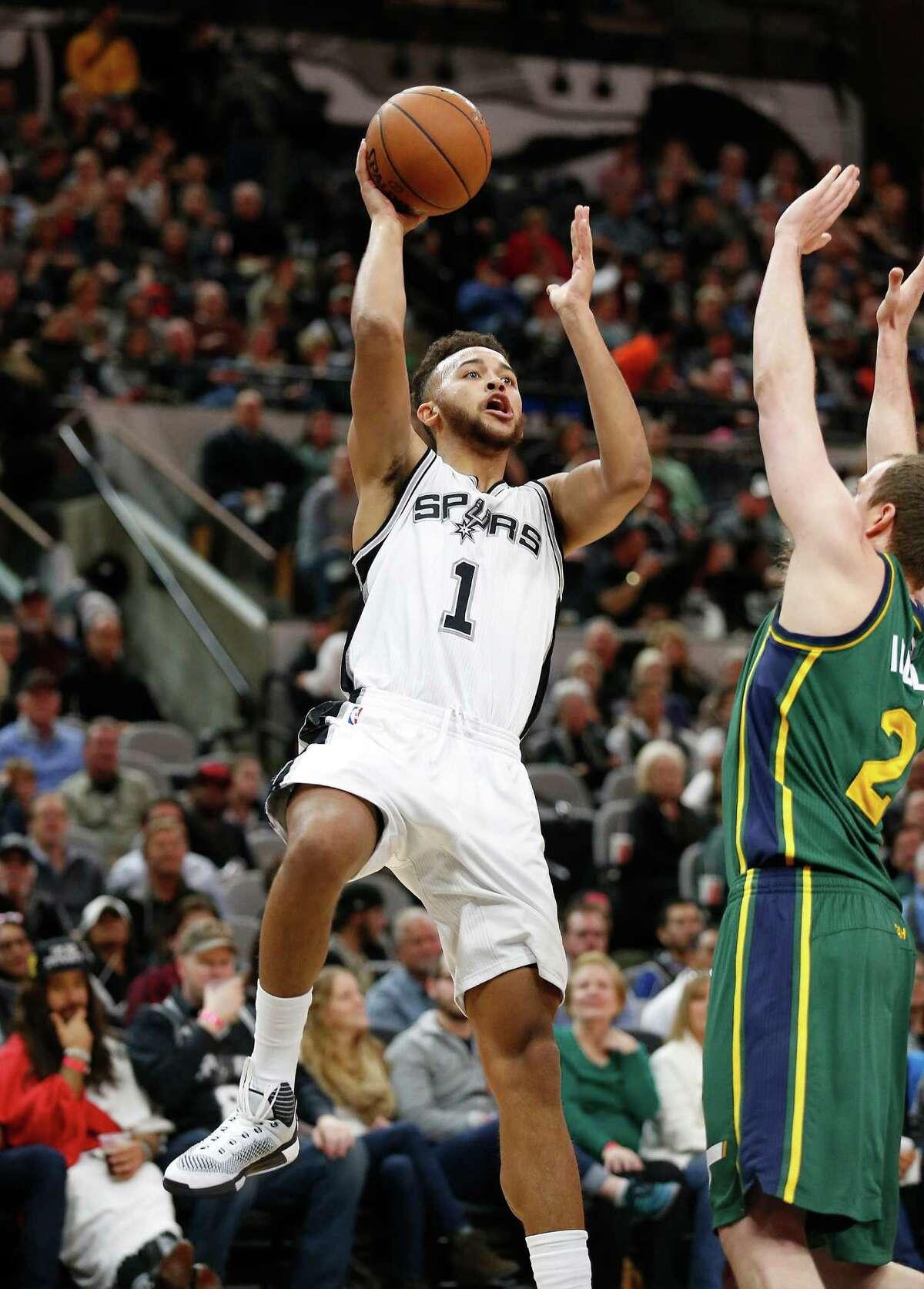 Spurs' Kyle Anderson takes a shot against Utah Jazz's Joe Ingles on Jan. 6, 2016.