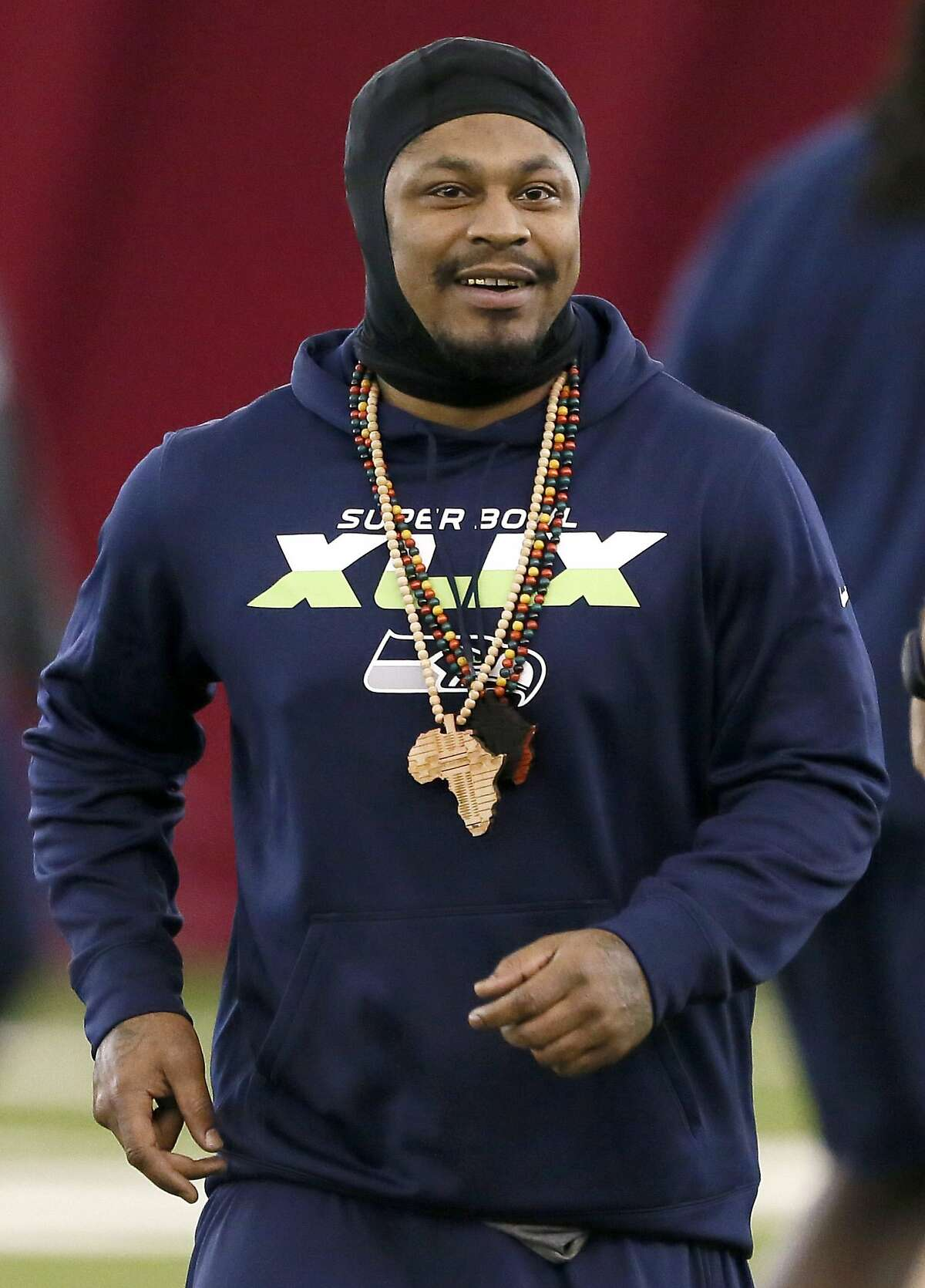 Seattle Seahawks' Marshawn Lynch smiles during a team walk through for NFL Super Bowl XLIX football game, Saturday, Jan. 31, 2015, in Tempe, Ariz. The Seahawks play the New England Patriots in Super Bowl XLIX on Sunday, Feb. 1, 2015. (AP Photo/Matt York)