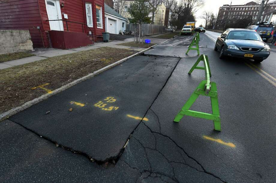 The pavement is lifted and Peoples Avenue is partially blocked after a water main break early Tuesday Feb. 2, 2016 in Troy, N.Y.      (Skip Dickstein/Times Union) Photo: SKIP DICKSTEIN