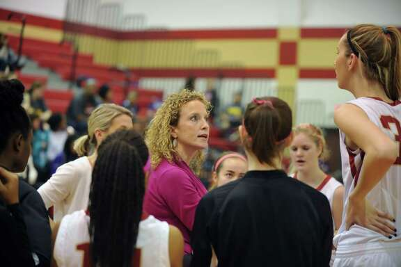 Jersey Village girls basketball team traveled to Cy Woods for a game, 1-29-2016.  Cy Woods won the game, 66-55.    Virginia Flores, Cy Woods coach, talks with the team during a time out.