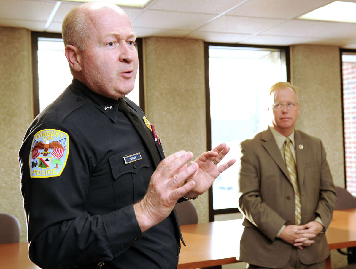 Danbury Police Chief Al Baker, left, addresses a press conference Monday called by Mayor Mark Boughton, right, on Monday, January 31, 2011.