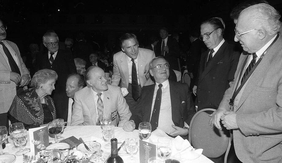 Herb Caen (second from left) sits with Dolores and Bob Hope and Lee Iacocca at a San Francisco Super Bowl party on Jan. 19, 1985. Photo: Frederic Larson, The Chronicle