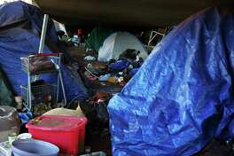 The unauthorized homeless encampment and site near Fourth Avenue South and Interstate 90 where three teens were arrested Monday afternoon in connection with last week's homeless shooting that left two dead and three injured.  Photographed Tuesday, Feb. 2, 2016.