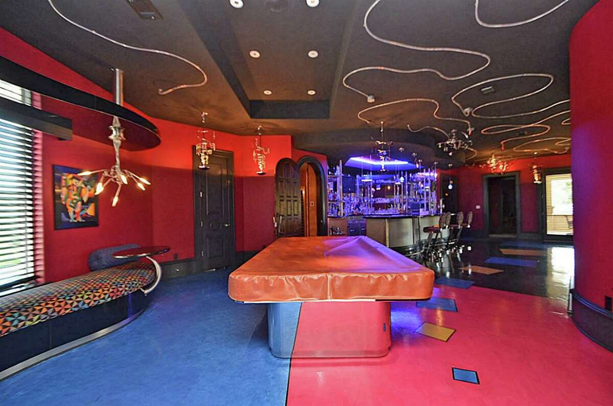 Situated at 21 Grand Manor in Sugar Land, is a man cave well suited for hosting game nights.