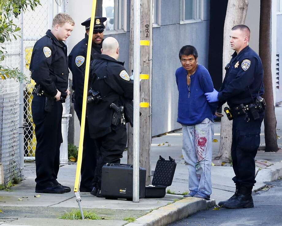 The suspect in police custody after he was arrested in connection to a stabbing of a CHP officer in San Francisco, California, on Tuesday, Feb. 2, 2016. Photo: Connor Radnovich, The Chronicle