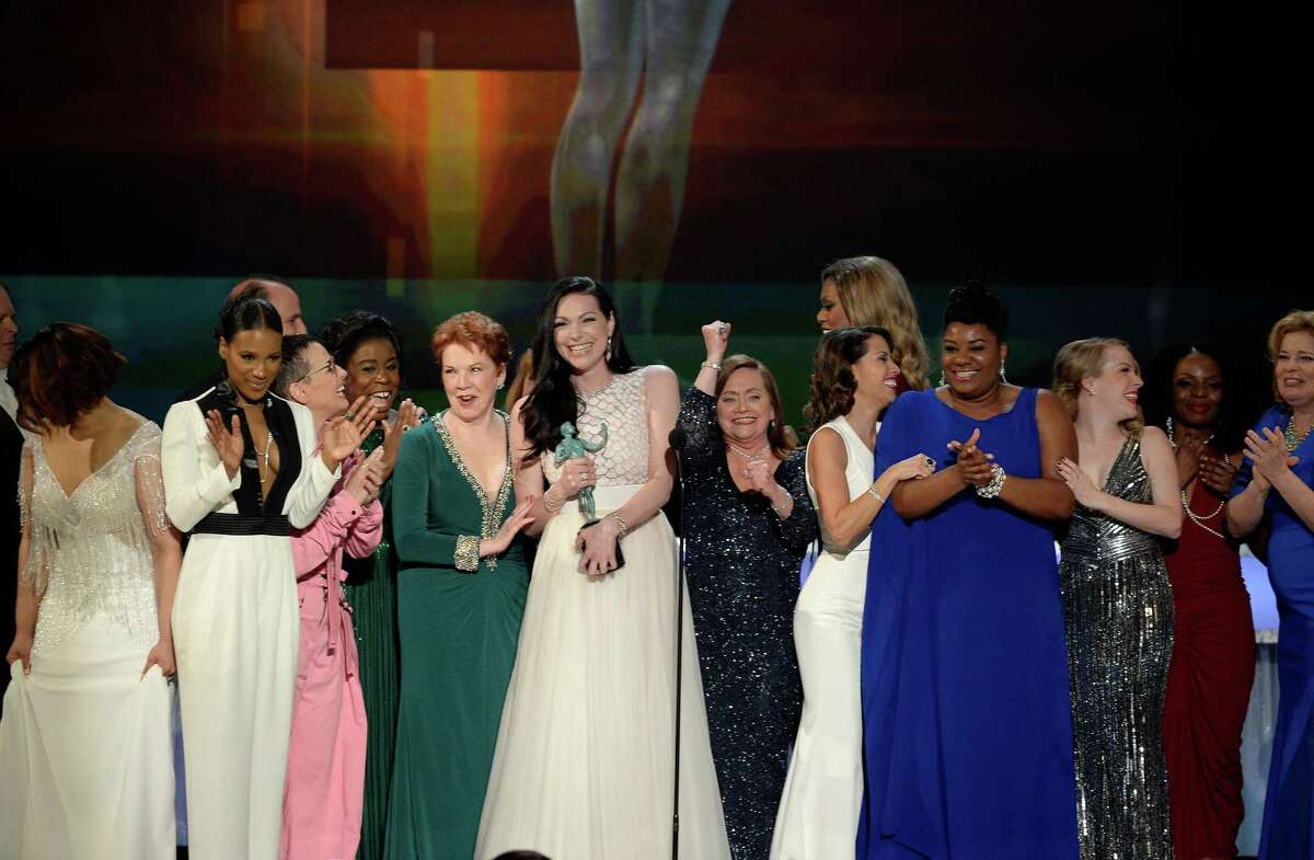 The cast of 'Orange Is the New Black,' including actors Vicky Jeudy, Lori Petty, Uzo Aduba, Kate Mulgrew, Annie Golden, Laura Prepon, Dale Soules, Laverne Cox, and Michelle Hurst, accept Outstanding Performance by an Ensemble in a Comedy Series.