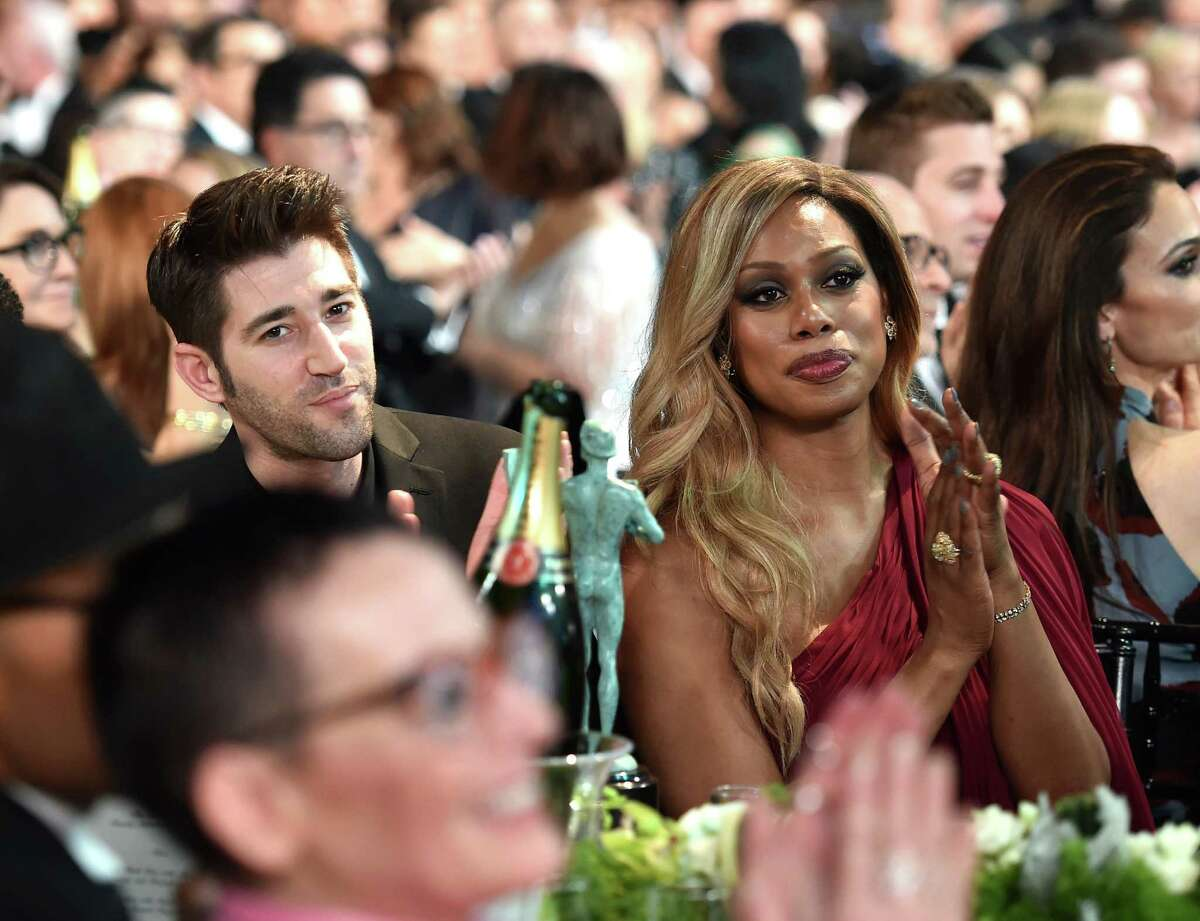 Actress Laverne Cox attends The 22nd Annual Screen Actors Guild Awards with her new boyfriend, Jono Freedrix.