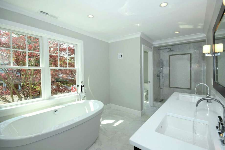 The en suite master bath features a deep Maax soaking tub, polished Carrara marble tiled-floors and a frameless glass step-in shower. Photo: Contributed / Contributed Photo / Darien News
