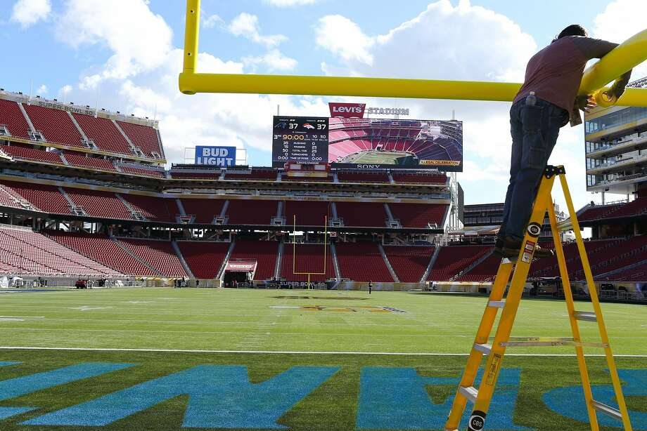 A man prepares a field post at Levi's Stadium in Santa Clara, Calif. on Tuesday, February 31, 2016. Photo: James Tensuan, The Chronicle