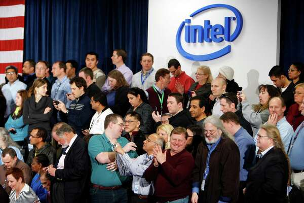 """Intel Corp. employees and guests await the arrival of U.S. President Barack Obama and Intel Chief Executive Officer Paul Otellini at an Intel semiconductor manufacturing facility in Hillsboro, Oregon, U.S., on Friday, Feb. 18, 2011. Obama said the U.S. needs to create a climate for businesses that will encourage investments to create jobs in the country, citing chipmaker Intel Corp. as an example of a company that has """"placed its bets on America."""" Photographer: Kevin P. Casey/Bloomberg"""