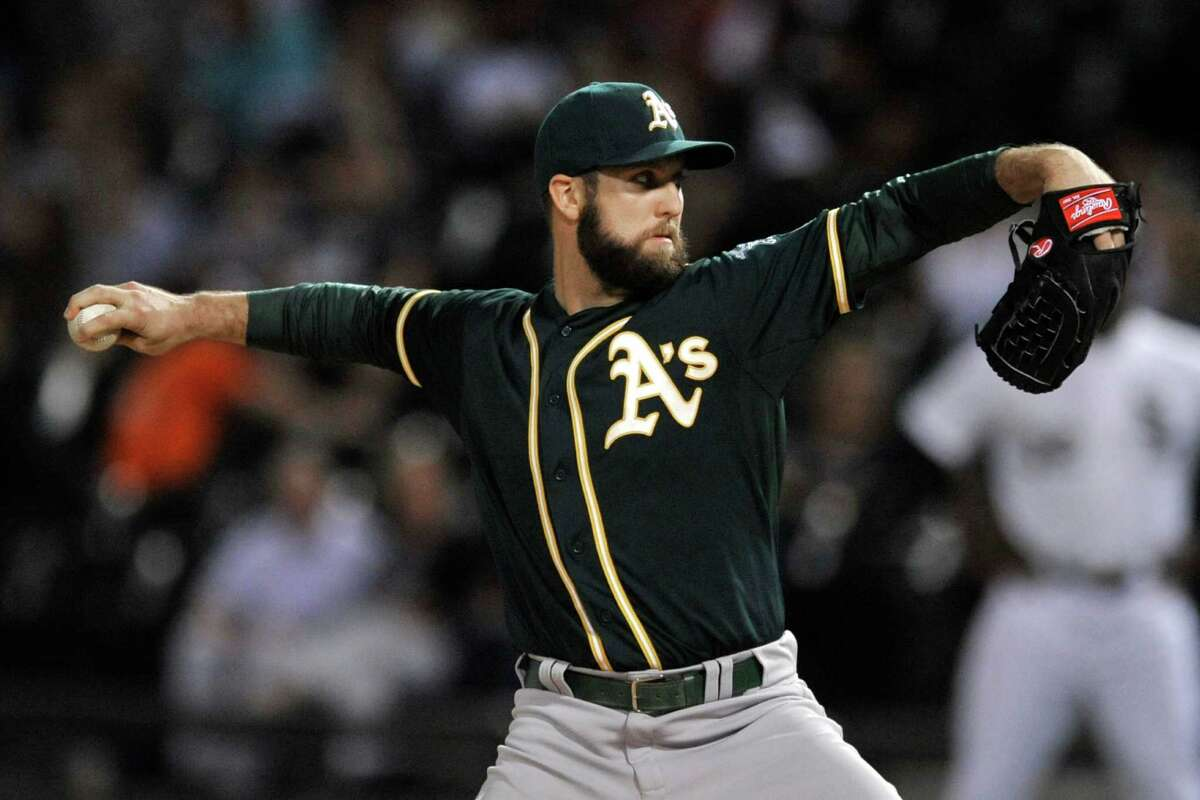 Oakland Athletics starter Cody Martin winds up during the first inning of a baseball game against the Chicago White Sox on Wednesday, Sept. 16, 2015, in Chicago. (AP Photo/Paul Beaty)