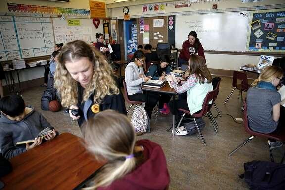 Principal Teresa Shipp (left) and teacher Yuka Walton help students in Yuka's advisory class at James Denman Middle School in San Francisco, California, on Tuesday, Feb. 2, 2016.