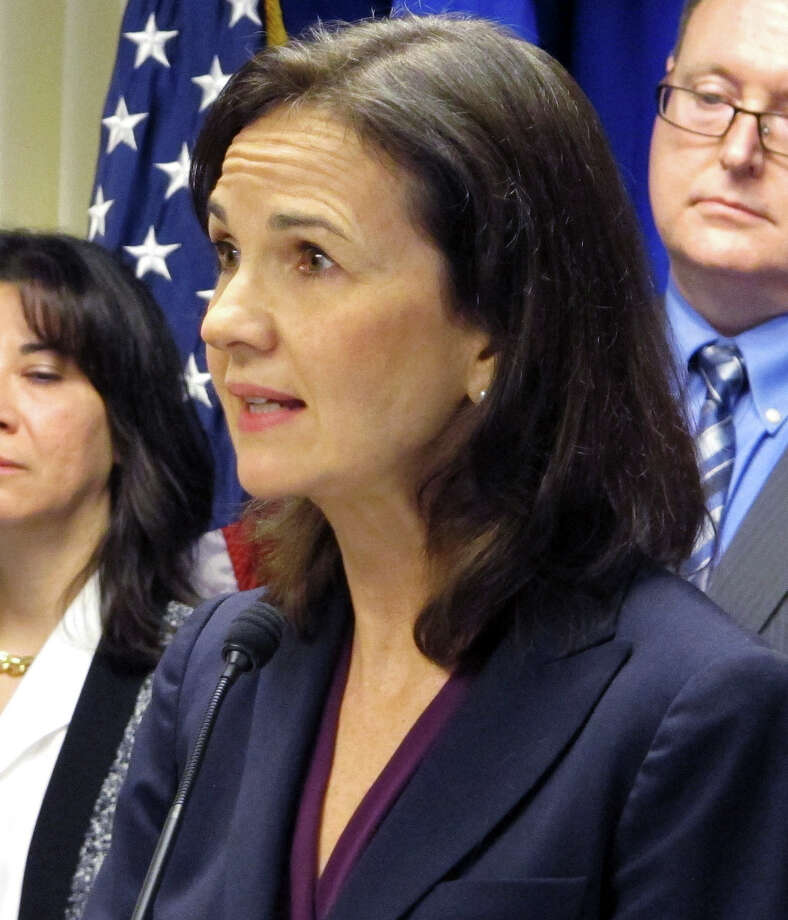 Deirdre Daly, the U.S. attorney for Connecticut, stands with other federal officials while announcing a new public corruption task force on Wednesday, Feb. 4, 2015. (AP Photo/Dave Collins) Photo: Dave Collins / Associated Press / AP